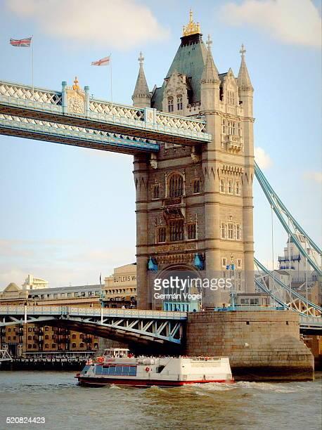 Boat sailing toward London Tower bridge in the Thames river.
