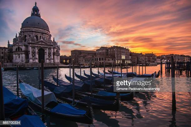 A boat sails a canal with Christmas lights on December 4 2017 in Venice Italy