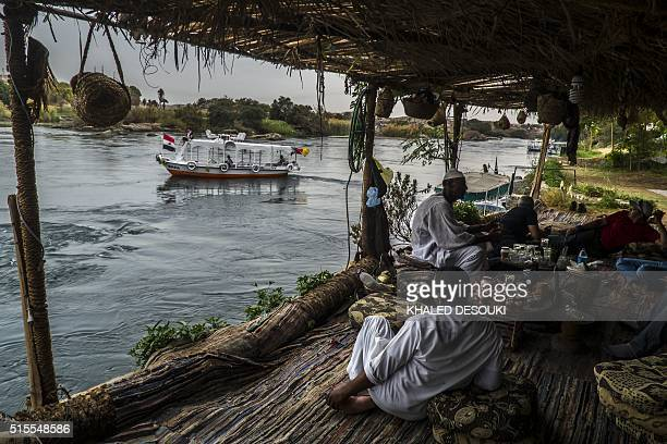 A boat sails along the Nile River in Aswan some 900 kilometres south of Cairo on March 13 2016 / AFP / KHALED DESOUKI