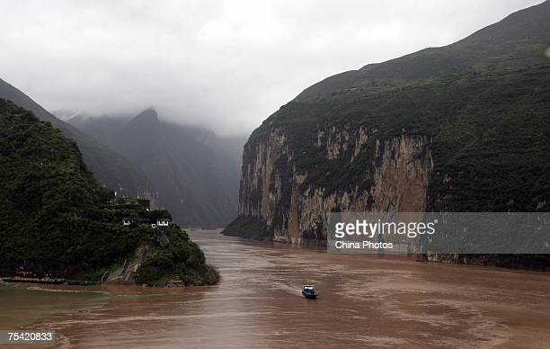 A boat sails at the Kuimen Gate of Qutang Gorge one of the Three Gorges along the Yangtze River on July 13 2007 in Fengjie County of Chongqing...