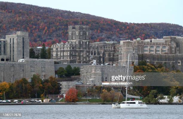 Boat sails in the Hudson River in front of the United States Military Academy, West Point on October 25, 2020 as seen from Garrison, New York.