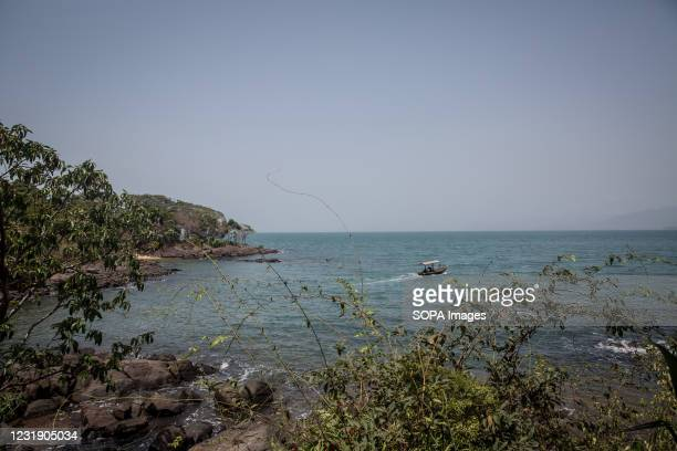Boat sails out of port from Sierra Leone's Banana Islands. The Banana Islands were once a slave trading port. They are now home to a few hundred...