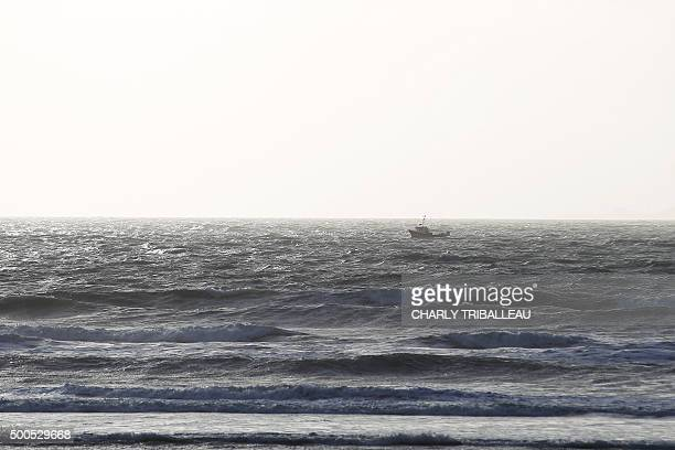 A boat sails past in BarnevilleCarteret northwestern France on December 8 2015 / AFP / CHARLY TRIBALLEAU