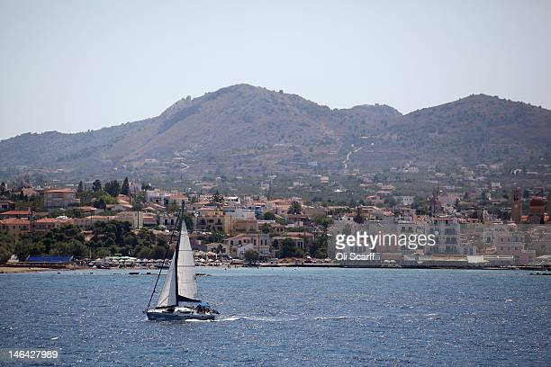A boat sails past the island of Aegina on June 16 2012 in Aegina Greece The Greek electorate are due to go to the polls tomorrow in a rerun of the...
