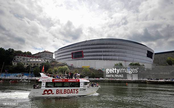 A boat sails past the new San Mames football stadium in the Northern Spanish Basque city of Bilbao on September 14 2013 AFP PHOTO/ RAFA RIVAS