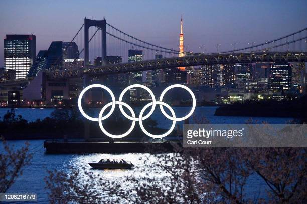 Boat sails past the Tokyo 2020 Olympic Rings on March 25, 2020 in Tokyo, Japan. Following yesterdays announcement that the Tokyo 2020 Olympics will...