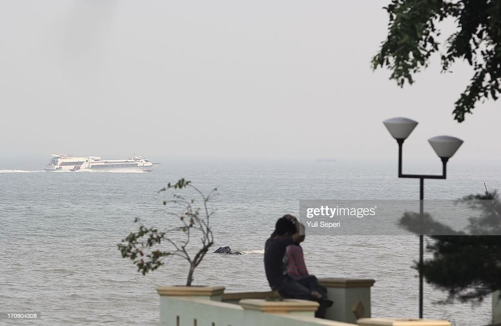 A boat sails through through haze pollution on the Riau Straits on June 20, 2013 in Bintan Island, Indonesia.The haze, which is created by the illegal burning of forestry in Sumatra in order to make way for palm plantations, is enveloping much of Indonesia, Malaysia and Singapore.