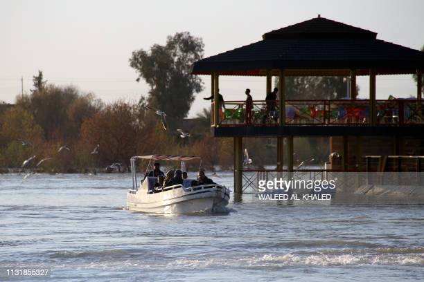 A boat sales in the Tigris river on March 21 at the site of a popular picnic area in the northern Iraqi city of Mosul after a ferry sank leaving more...
