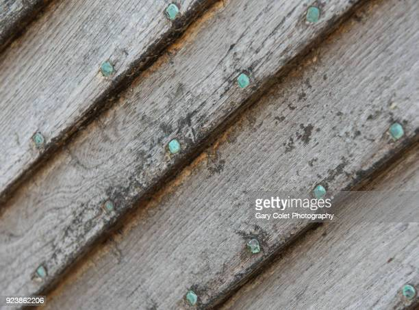 boat shiplap with copper nailheads - gary colet stock pictures, royalty-free photos & images