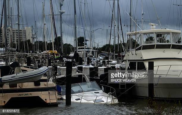 Boat sits submerged in water after the passing of Hurricane Matthew in Titusville, Florida on October 7, 2016. Fierce Hurricane Matthew left behind...