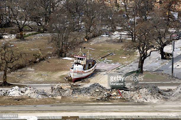 A boat sits where a house once stood on beach front property on US Highway 90 September 9 2005 in Biloxi Mississippi Damage from the storm is...