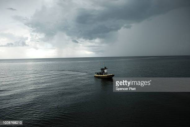 A boat stands near the Naples Pier on September 7 2018 in Naples Florida Despite being largely clear of the red tide that has plagued the shoreline...