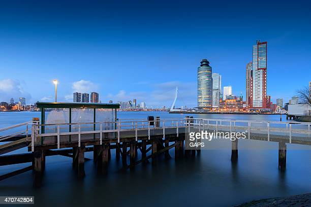 boat stop along rotterdam's meuse river - meuse river stock photos and pictures