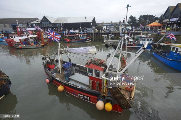 A boat takes part in a demonstration in Whitstable southeast England on April 8 2018 against the Brexit transition deal that would see Britain...