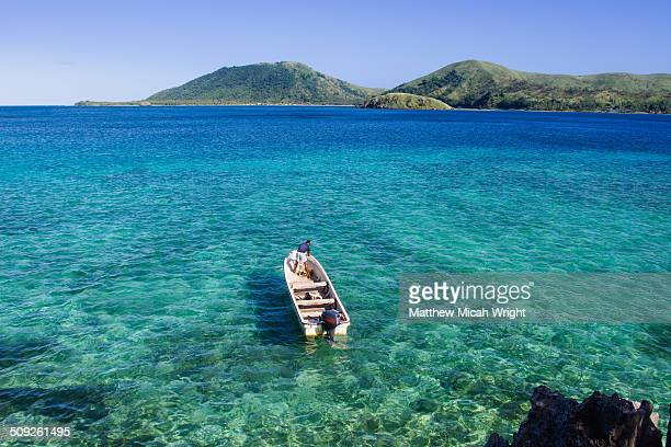 a boat takes passengers to the sawa-i-lau caves - fiji stock pictures, royalty-free photos & images