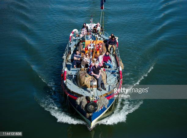 A boat taking tourists on a trip around Whitby Bay returns to the harbour on Easter Sunday on April 21 2019 in Whitby United Kingdom Easter weekend...