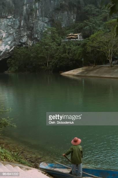 boat through river in phong nha ke bang - bang boat stock pictures, royalty-free photos & images
