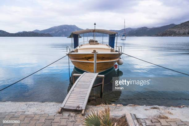 boat tied to a dock - aegean turkey stock pictures, royalty-free photos & images