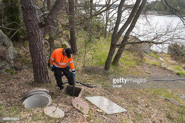 boat to collects sewer from septic tank in stockholm archipelago - septic tank stock photos and pictures