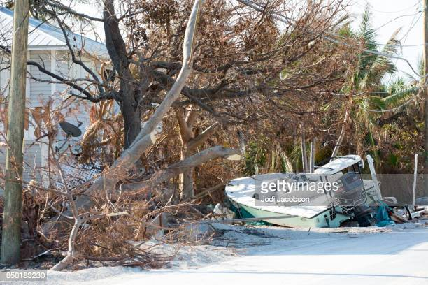 Boat tossed on land in Cudjoe Key, Florida from Hurricane Irma