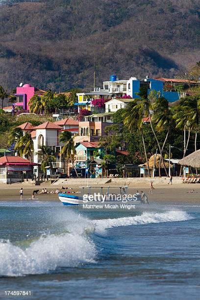 A boat tour leaves San Juan harbor