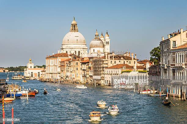 boat traffic on the grand canal in venice, itlay - vaporetto stock photos and pictures