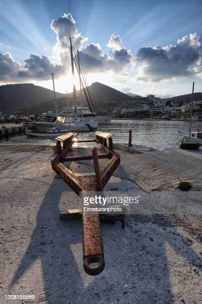 boat trailer and anchored boats in datca marina. - emreturanphoto stock pictures, royalty-free photos & images