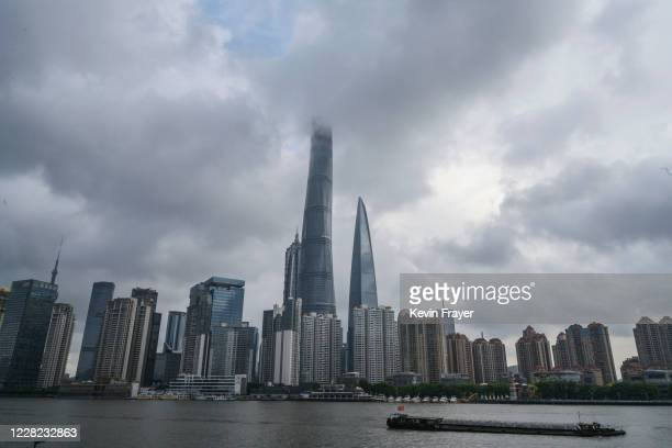 Boat travels on the Huangpu River as the skyline of the city is is seen, including the Shanghai Tower, center, on August 28, 2020 in Shanghai, China.