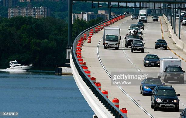 Boat travels on the Potomac River as cars travel over the Woodrow Wilson Bridge on September 4, 2009 in National Harbor, Maryland. The American...