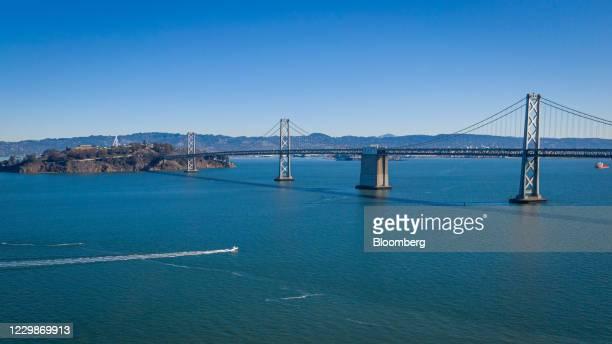 Boat travels towards the San FranciscoOakland Bay Bridge in San Francisco, California, U.S., on Friday, Nov. 27, 2020. Californiareported 15,614 new...