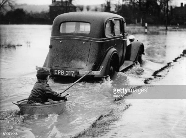 Boat trip of a little boy at at flooding in Yalding near London Photograph 1937 [Ein kleiner Junge ntzt die berschwemmung in Yalding bei London fr...