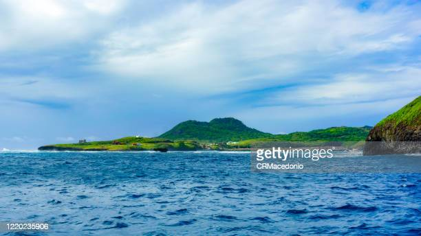 boat trip through the bay of santo antonio. in front of são josé island and in the background ruins and buildings, including the chapel of são pedro dos pescadores. - crmacedonio stock pictures, royalty-free photos & images