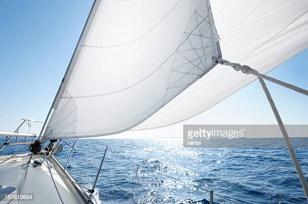 Boat under sail on a sunny day