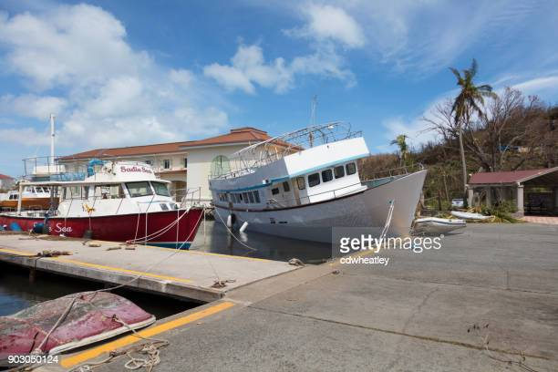 boat up on dock after hurricane Irma, St John