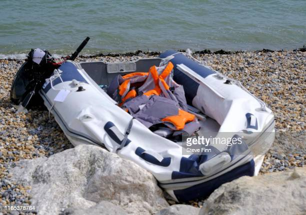 A boat used by migrants on the shore at Kingsdown Beach August 31 2019 in Dover England 53 migrants have been intercepted crossing the English...