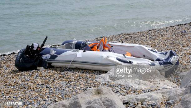 Boat used by migrants on the shore at Kingsdown Beach August 31, 2019 in Dover, England. 53 migrants have been intercepted crossing the English...
