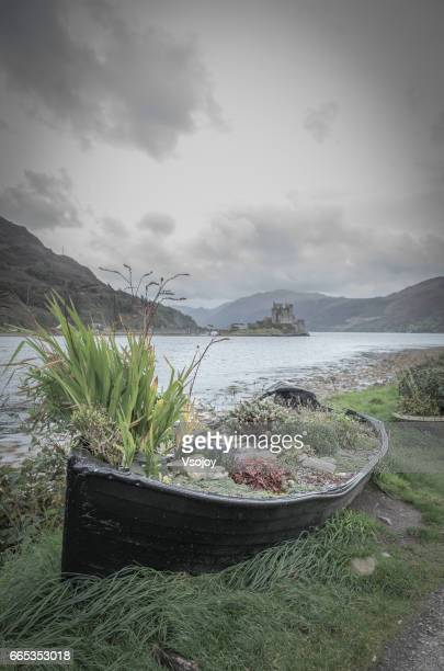 A boat vase and Eilean Donan castle at the oppoist shore, Skye, Scotland