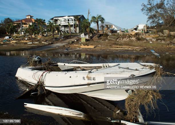 A boat washed down a hill sits by destroyed houses near Port St Joe Florida on October 12 two days after hurricane Michael hit the area Rescue teams...