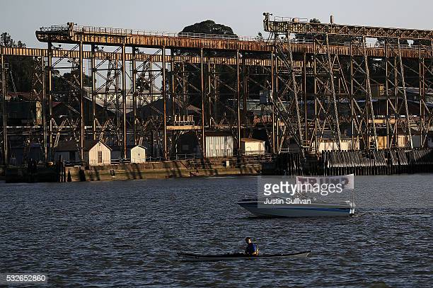 A boat with a banner in support of Republican presidential candidate Donald Trump navigates the Napa River near a campaign rally for Democratic...