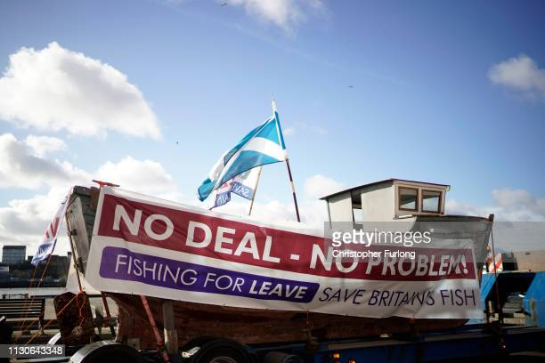 A boat with a No Deal No Problem sign attached to it on the quay side at North Shields as campaigners prepare for the Fishing For Leave flotilla on...