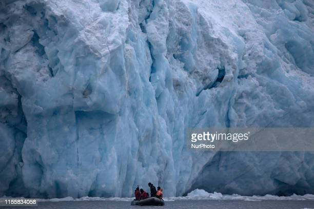A boat with divers close to Fourcade Glacier in the Cove Potter near the argentian Carlini Bases in 25 de Mayo Island Antartica