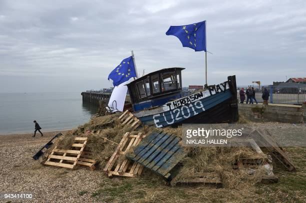 A boat with European flags attached sits on top of a bonfire waiting to be lit at a demonstration in Whitstable southeast England on April 8 2018...
