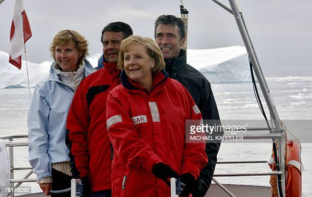 A boat with German Chancellor Angela Merkel German Environment Minister Sigmar Gabriel Denmark's Prime Minister Anders Fogh Rasmussen and Denmark's...