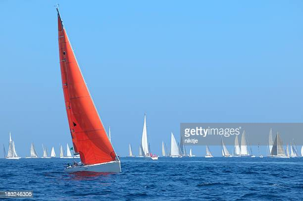 Boat with red sail