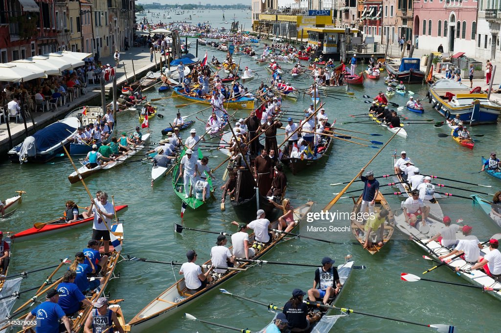 A boat with rowers dressed up as monks tries to negotiate the entry at Ponte dei Tre Archi on Canale di Cannaregio during the 38th Vogalonga on May 27, 2012 in Venice, Italy. The Vogalonga is a non-competitive paddling/rowing race that follows a 30 kilometre scenic route through the city of Venice. The race began in 1975 with a message of raising awareness of the damage caused by motorboats to the historic city and contrasts it with that of Venice's rowing tradition. This year's event, now in its 38th year, saw record breaking numbers of participants both local and international, with more than 1700 boats and 6000 rowers.