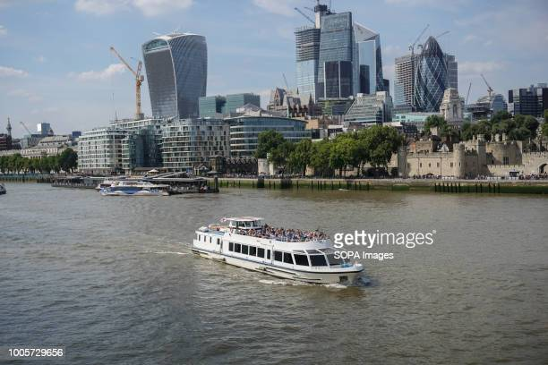 A boat with tourists seen making its way along the River Thames High temperatures in the United Kingdom will continue and the temperatures will be 35...