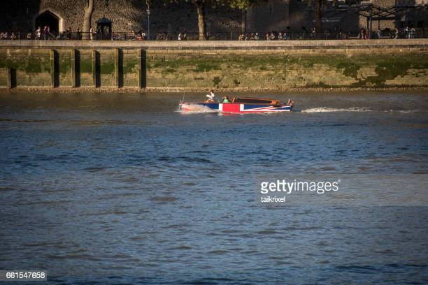boat with union jack on thames river, united kingdom, europe - greater london stock pictures, royalty-free photos & images