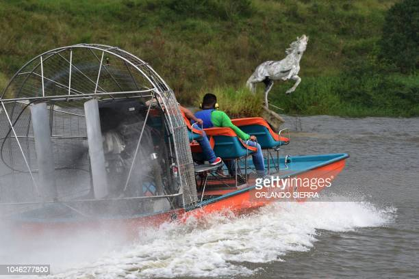 A boat with visitors is seen at an artificial lake of the Joya Grande zoo and ecopark in Santa Cruz de Yojoa Cortes department 160 km north of...