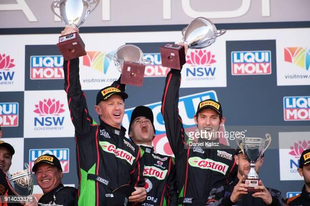 Aaron Seton Matt Brabham Anthony Longhurst celebrates on the podium during the 2018 Bathurst 12 Hour Race at Mount Panorama on February 4 2018 in...