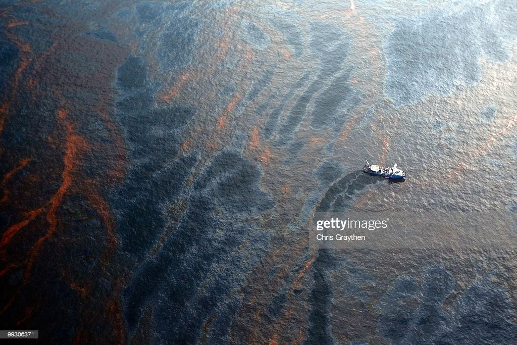 A boat works to collect oil that has leaked from the Deepwater Horizon wellhead in the Gulf of Mexico on April 28, 2010 near New Orleans, Louisiana. An estimated leak of 1,000 barrels of oil a day are still leaking into the gulf.